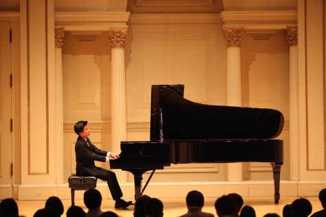 "Pictured above is freshman Kyle Chen, a competitive pianist who has been playing for eight and a half years. ""I have to keep on going and just don't quit."" Chen said."