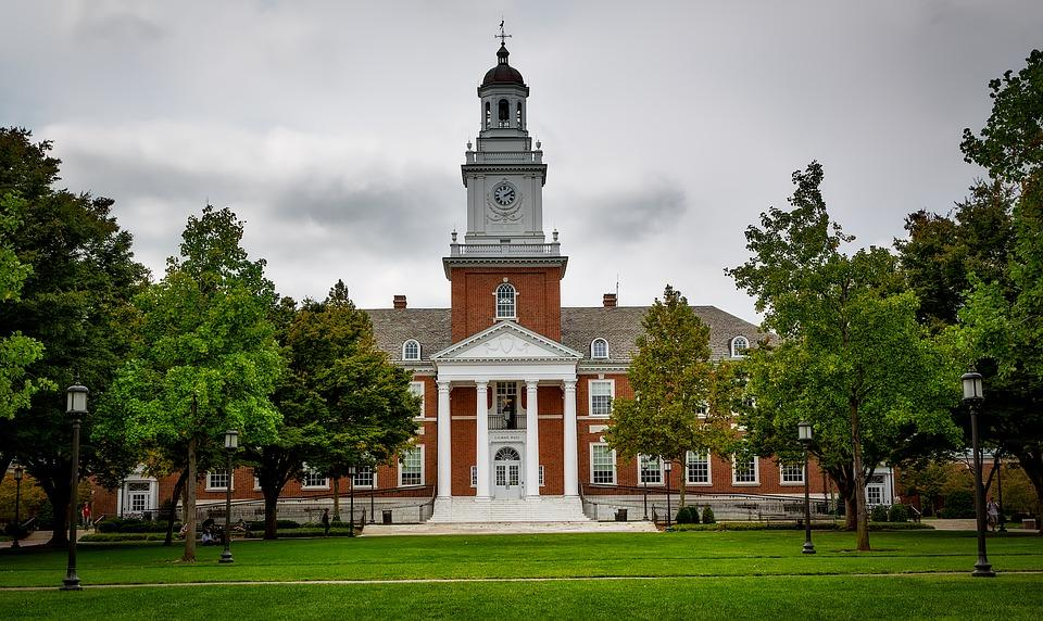 Pictured above is Gilman Hall at Johns Hopkins University. Seniors around the country are applying early decision for their choice college. Several pros and cons influence the choice to apply early instead of applying for regular decision.