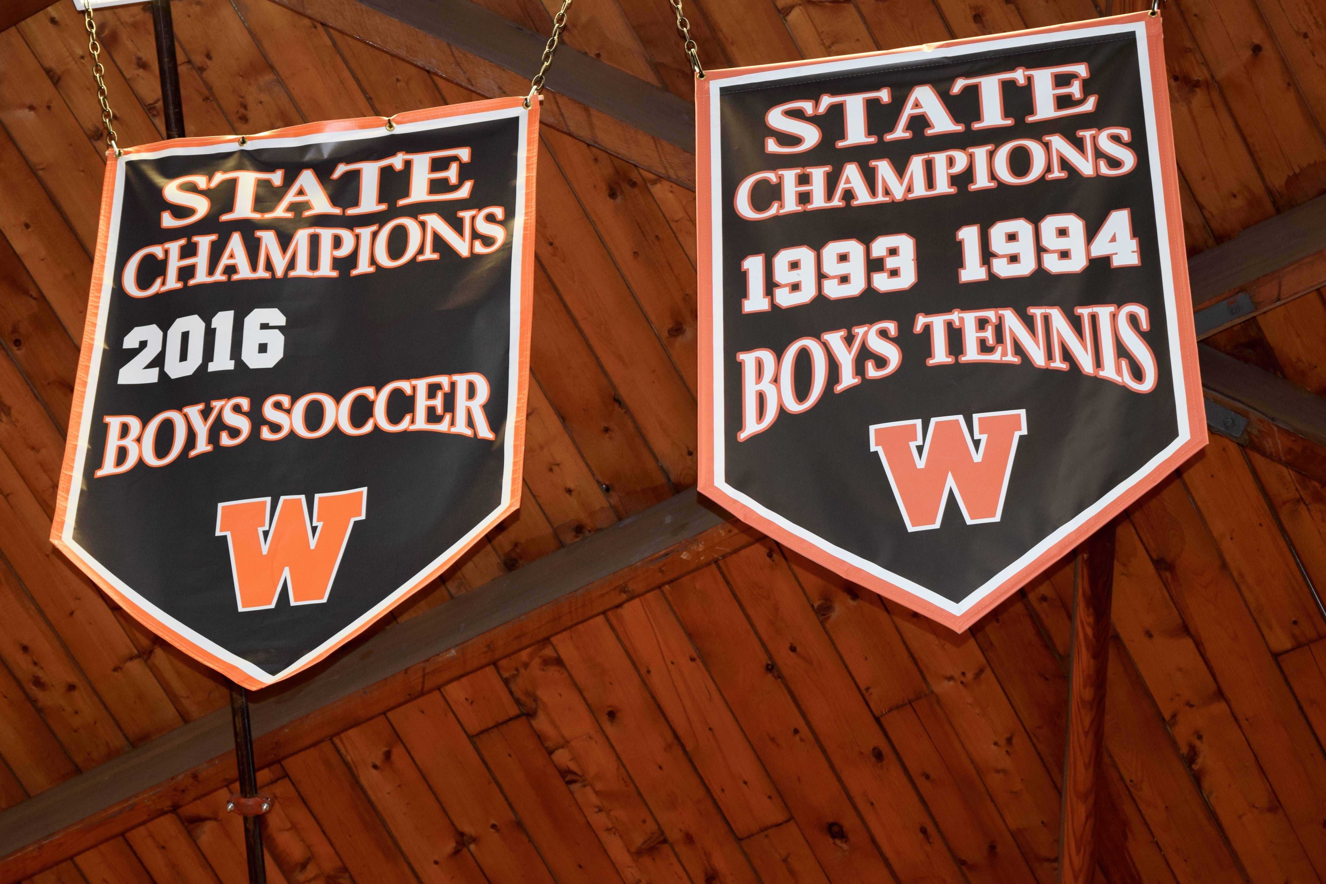"Pictured above are the State Championship banners hanging in the field house. Andrew D'Amico writes ""If you're not training for the majority of the year to become the best at one sport, someone else is, and chances are, you're going to lose to them."""