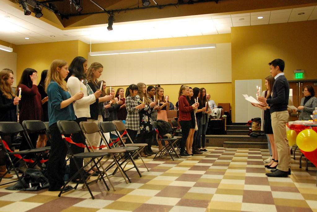 """WHS inductees are sworn in  at the Spanish National Honor Society induction ceremony. """"We're hoping that [the inductees] promote throughout the school the idea of the importance of learning another language,"""