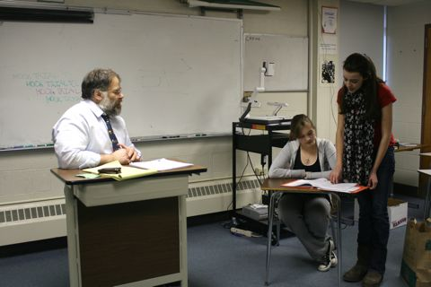 Wayland Mock Trial members Andrea Tempesta and Bridget Smith rehearse under the guidance of attorney-coach Howie Lenow. (Credit: Shensi Ding/WSPN)