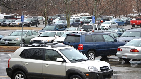 At the end of the school year the current student parking lots and one faculty lot will close to as the land is prepped to pave the way towards a new high school building. (Credit: David Ryan/WSPN)