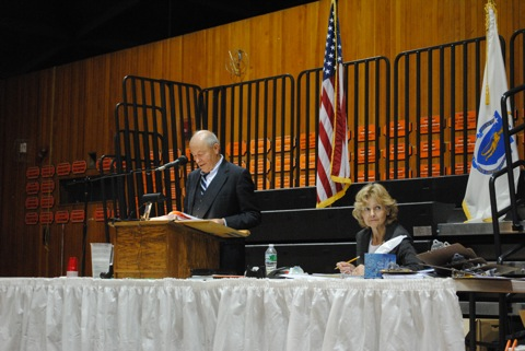 The town moderator oversees debate on the town meeting floor during a recent town meeting.