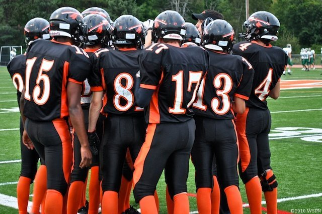 The Warriors in a pre-game huddle with Coach Cincotta. (Credit: Jake Adelman/WSPN)