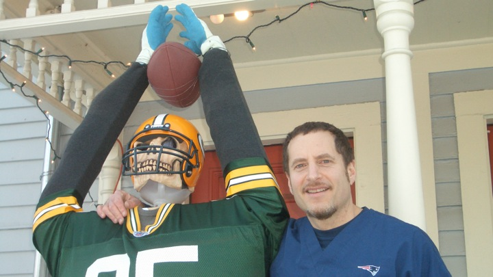 Local chiropractor Matthew Cooper poses with his Super Bowl themed dummy. (Credit: Oliver Levin/WSPN)