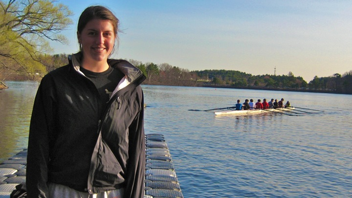 Senior Catherine Chappell stands on the dock at Lake Cochituate where she practices with the Wayland-Weston crew team. (Credit: Elaine Hunt/WSPN)