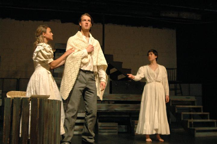 Carly McKee (far left) as Cosette comforts Seth Lifland, who plays her adoptive father Jean Valjean. Jade Donaldson (far right) reaches out to them as the ghost of Cosette's mother, Fantine. (Credit: Melanie Wang/WSPN)