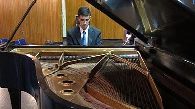 Senior Tim Caradonna warms up on Wayland High School's grand piano. (Courtesy: WHS Fine Arts)