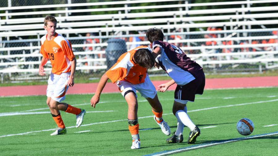 Caroline Bache, Taylor Fletcher and Jamie Carver are all playing on the varsity soccer teams as freshmen. Above, Carver (number 29)  helps his teammate Andrés Pascual-Leone in a game against Westford Academy.