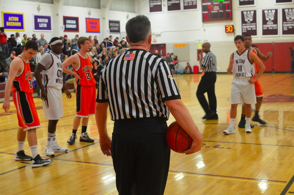 """Police officers were present at Friday night's Wayland versus Weston basketball game at Weston High School in response to the escalated Wayland-Weston rivalry shown on Facebook and at Wednesday night's Wayland versus Weston hockey game. """"Some of my guys who were at the hockey game heard people saying, 'We'll get you on Friday,'"""" Weston Chief of Police Steven Shaw said."""