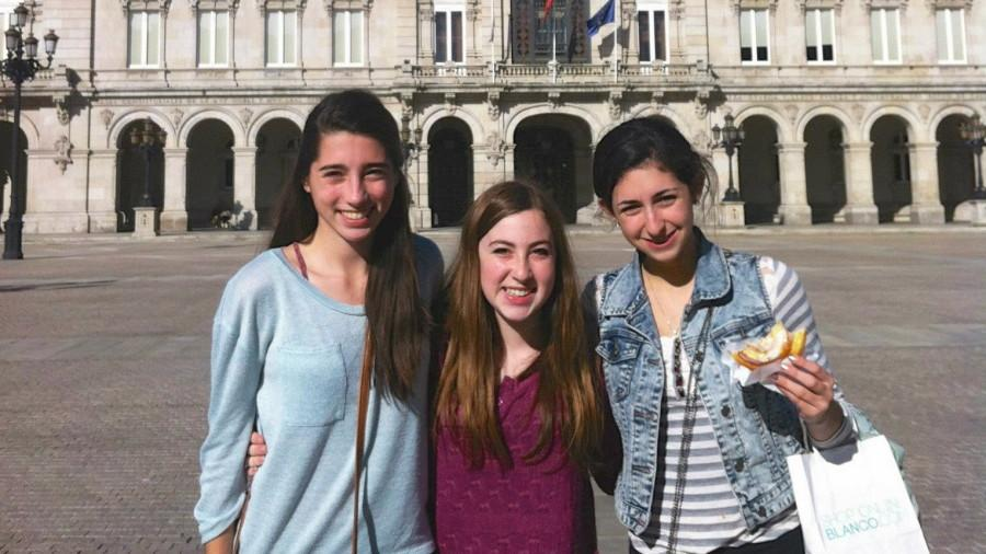 """Above, seniors Maddie Conroy, Sarah Mitty, and junior Julia Chinman visit Betanzos, Galicia, Spain. This week, students from IES Francisco Aguiar will come to Wayland as part of an exchange program. """"[Everyone in Spain] was very friendly to me,"""" senior Sammy Karle, another student who went to Betanzos last year, said. """"Life moves a little slower there; everyone is calm, and it is more relaxed there than it is here in America."""""""