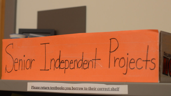 """Pictured above is the senior independent projects bin in the Academic Center. This year there are 21 seniors doing 14 senior projects, varying from reciting oral history to building a boat. I think it's [nice] to be able to be excused from classes to focus on something that you really enjoy doing,"""" senior Mylinh Tran said."""