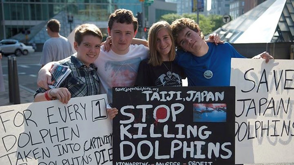 Pictured above is junior Anne Flaherty, protesting the killing of dolphins in Taiji, Japan. (Left to right: Declan Nolan, Mike Ahearne, Anne Flaherty and Dan Castillo)