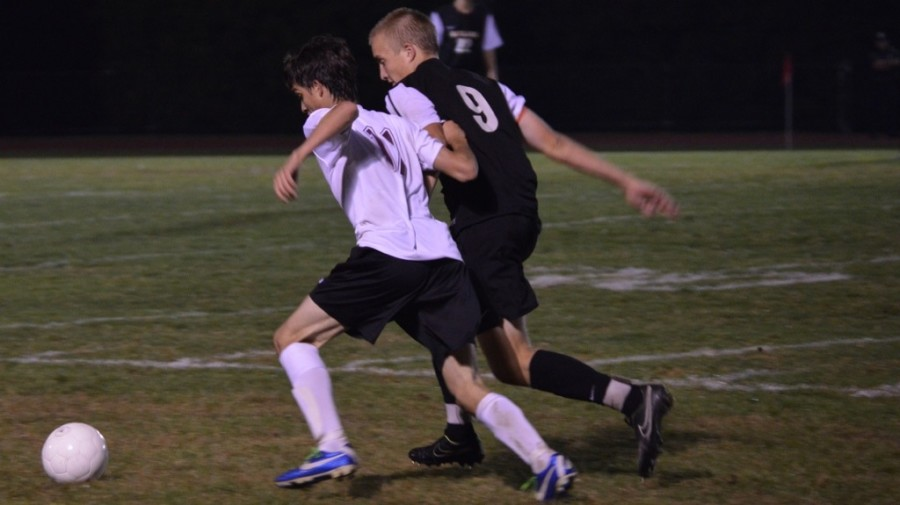 """Above is the Wayland boys' soccer team playing against Weston earlier this season. Today, they will play in the semi-finals against Tewksbury. """"Our goal is to try to put them under a lot of pressure, so that we can open up scoring opportunities,"""" head coach David Gavron said."""