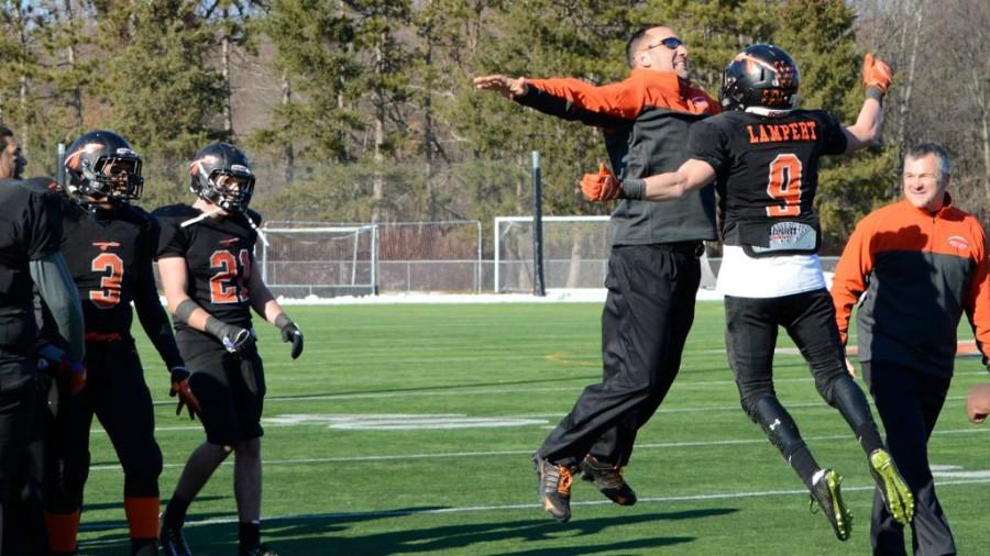 Above,  coach Scott Parseghian (center) celebrates  Wayland's win against Weston in the annual Thanksgiving football game. Wayland High School graduate Ben Porter writes in support of Parseghian.