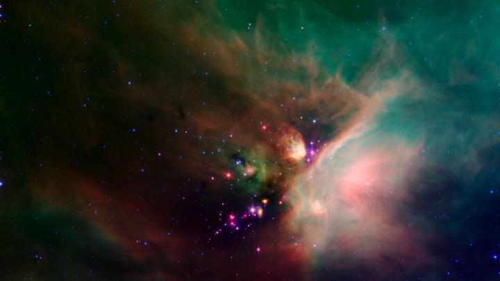 """Pictured above is a rendered image of the Rho Ophiuchi cloud complex using data taken from the Spitzer Space Telescope. Astrophysicist Dr. Giovanni Fazio of the Harvard-Smithsonian Center spoke at Wayland High School about his involvement with the construction of the space telescope.  """"You had your whole life's work, almost, invested in that telescope and you just had to pray that that rocket was going to work. And fortunately, it did,"""" Fazio said."""