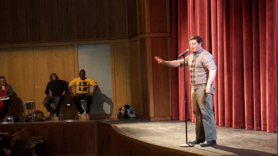 Pictured above is the poet Nicholas performing.