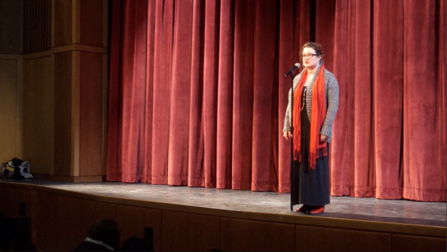 Pictured above is the poet Sarah performing.