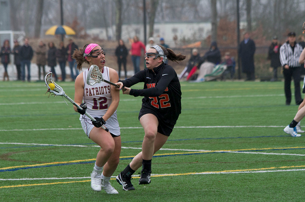 """Pictured above is senior Taylor Frieling, right, playing in a game against Concord-Carlisle. """"I just go out there every single game and try to give it my all,"""" Frieling said."""