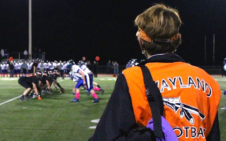 Above, athletic trainer Chris Brown watches a football game last fall. After the 2014-2015 school year, Brown will be retiring. It's the best community ever. The best kids, families, town, I couldnt have been happier here, Brown said.