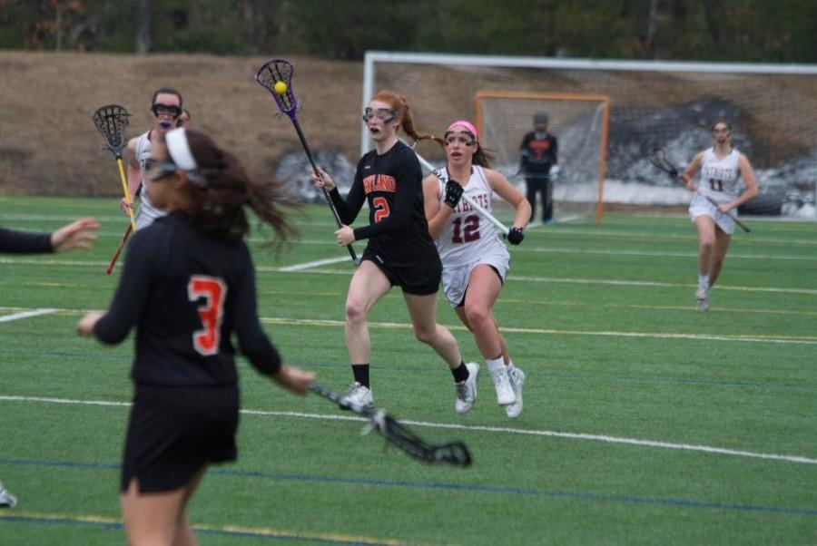 """Pictured above is senior Emily Barnard. Barnard was recently recruited to Middlebury College for lacrosse. """"As soon as you start playing. the nerves go away, and you're just playing the game,"""" Barnard said."""