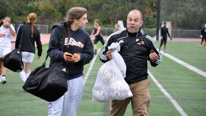 """Pictured above is senior Taylor Fletcher talking to one of the girls soccer coaches, Ed DeHoratius. Fletcher has been on the varsity team since her freshman year. """"Soccer makes me feel like Im on top of the world. I love the physical excursion, the competition and the mental toughness that it requires, Fletcher said."""