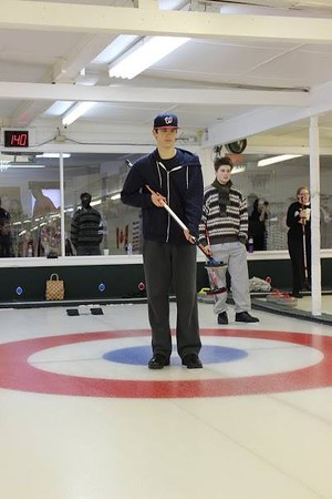 "Pictured above is junior Peter Tsipis curling at Broomstone's Curling Club in Wayland.  He has been curling since the 2nd grade. ""I can be really competitive during the match, but at the end of the day, I'm still curling with the same people I've curled with for ten years, and I have great friendships with them,"