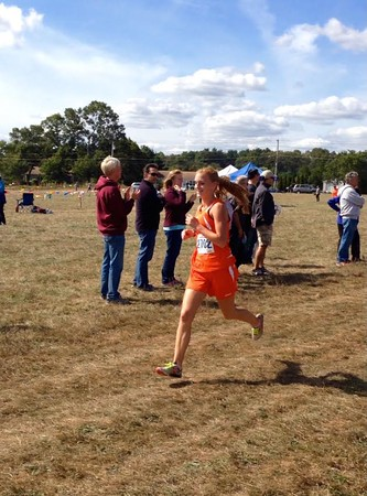Above is junior Sarah Tully competing in a cross-country race. Tully has made it to two all-state meets in high school.