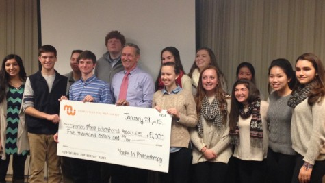 Picture above is one of the check presentations to a nonprofit by a YIP class.