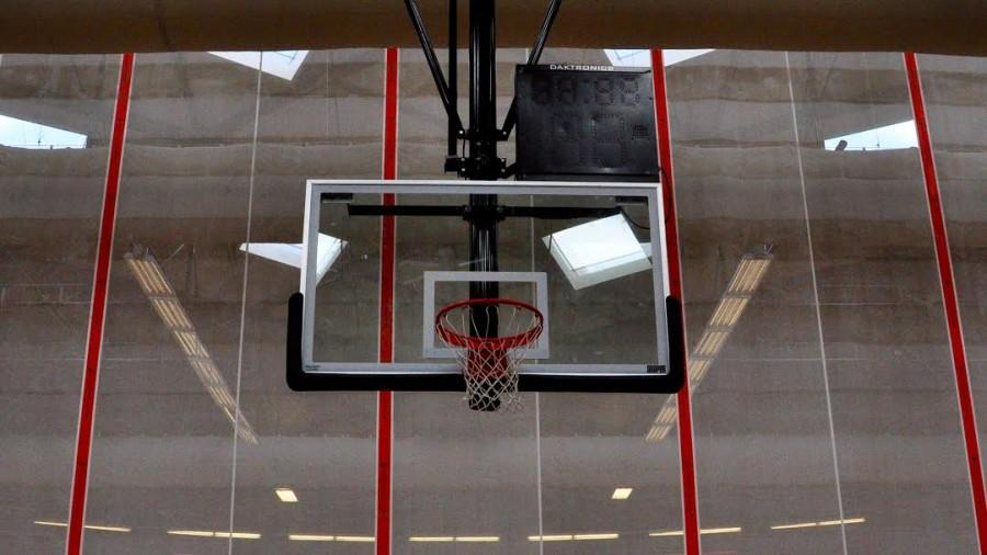 """Pictured above is a basketball hoop in Wayland High School's field house. This season, the girls' basketball team welcomed Heather Hughes as a new assistant coach. """"It should be a great season, and I am excited to be a part of the WHS coaching staff, school and community,"""" Hughes said."""