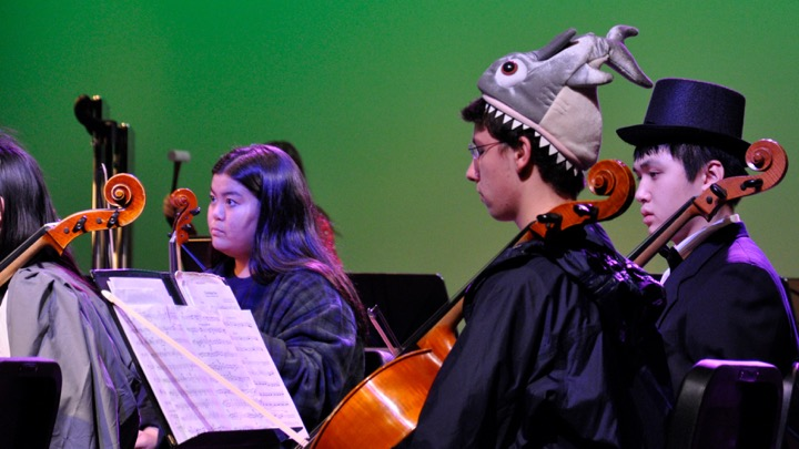 Above, junior and new Tri-M member Matt Ludwig (center) plays cello in the WHS orchestras masquerade concert on October 28. Tri-M is an international music honor society that recognizes middle and high school students. [Tri-M] is beneficial to the music community here, and colleges recognize the honor and commitment that is being bestowed and undertaken, advisor and fine arts department head Susan Memoli said.