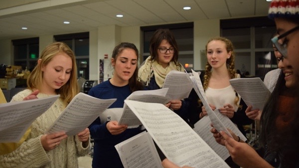 Above, members of the WHS Muses rehearse. Senior and co-director Lila Masand plans to record a CD with the group this year. I hope that I can provide the girls with that experience so that we will all remember each other and cherish the memories that we've made, Masand said.