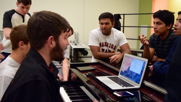 """Above are members of the WHS Testostertones at a rehearsal. According to junior Omar Rios, a member of the group, rehearsals are lighthearted but productive. We fool around sometimes, but we'll be serious when we need to be,"""" Rios said."""