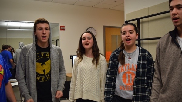Above are members of the WHS Madrigals rehearsing. Madrigals members expressed appreciation for the bonds they have formed as a group. We've always got each others backs, and we all come from different backgrounds with different interests, co-director senior Jimmy Lampert said.