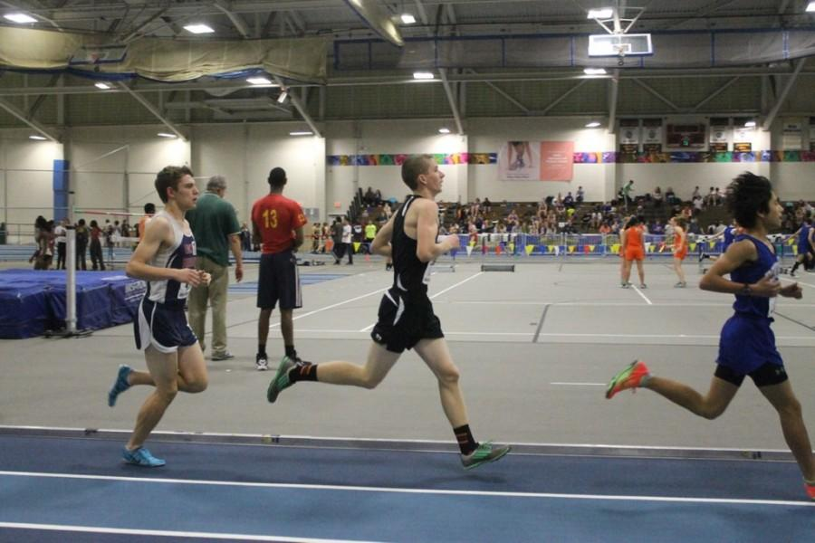 Above is senior Zach Last running a race during this year's indoor track season. Last has been a three-season runner for WHS since his freshman year.
