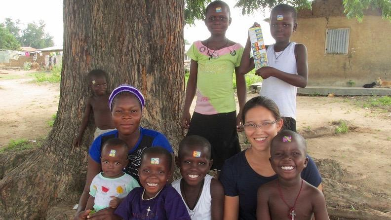 """Above is Lindsay Gardel (bottom right) with a few children she used to work with. Gardel, an alumna of WHS, discusses her work in the Peace Corps in Benin, Africa. """"You learn a lot about different cultures and the way that people live when they have a different socio-economic status,"""" Gardel said."""