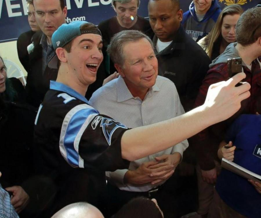 """Pictured above is junior Peter Tsipis taking a selfie with Republican presidential candidate John Kasich. """"I was surprised with how close I was to him when I got to hear him speak. His rallies let people get very close and personal which I really like in a candidate,"""