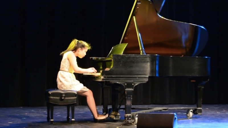 """Pictured above is Kara Chuang. She has played piano for 11 years and is a competitive pianist. """"Music plays an extremely important role in my life,"""" Chuang said."""