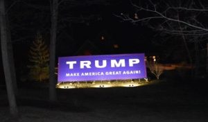 Pictured is the sign lit up at night.