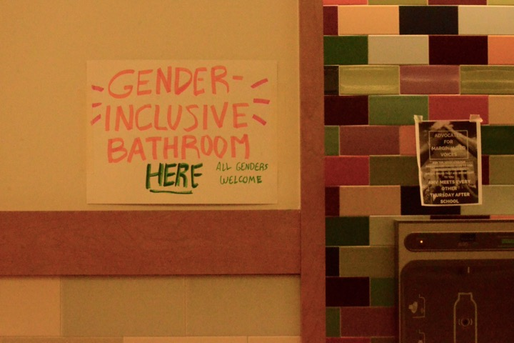 "Pictured above is the temporary sign posted outside of the gender inclusive bathrooms in WHS' English pod. Beginning this fall, students may use these bathrooms regardless of their gender identity. ""[The change] has enjoyed so much support from so many different corners of campus,"" principal Allyson Mizoguchi said."