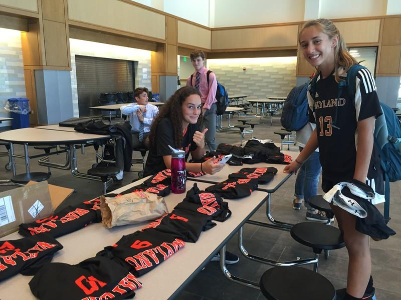 """Pictured above are sophomore Eden Vanslette and junior Brooke LaPierre collecting their uniforms for girls varsity soccer. Many WHS sports teams are receiving new uniforms this year. We picked the 5 last teams that were the oldest uniforms in the school, and those go back a scary amount of time,"""" Athletic Director Heath Rollins said."""