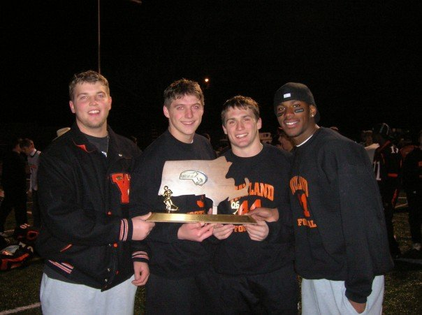 Team captains Henry Hastings, Ben Sherry, Chris Lash, and Tony Torres hold up the 2006 state Super Bowl trophy following the Warriors win over Marshfield.