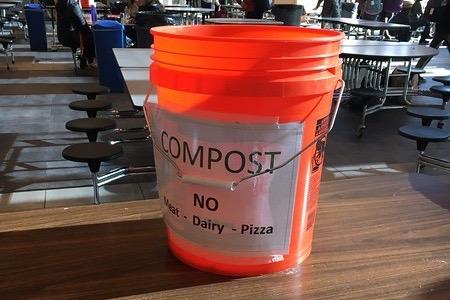 """Above is a compost bucket in the Commons. WHS Green Team recently introduced these stations to lunches. """"It's something everyone can do so easily, and we can help our environment at the same time. What else can you ask for?"""" said senior Callie Junkin."""