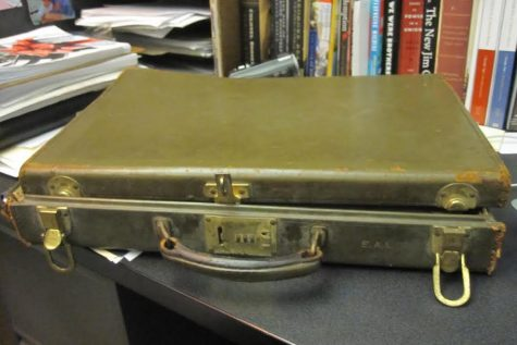 Attic Archaeology class studies mystery briefcase