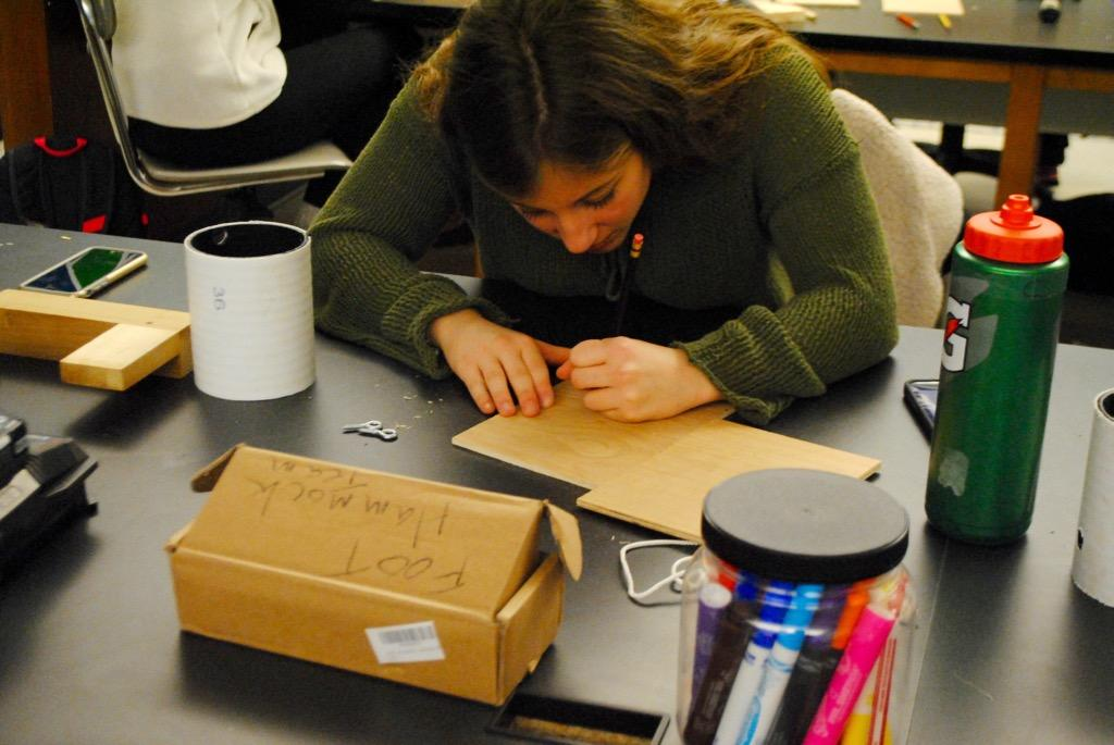 Pictured above is a student building a birdhouse at History Department Head Kevin Delaney's woodworking workshop. Delaney hosted the workshop in the makerspace on Friday as a part of WHS' annual winter week.