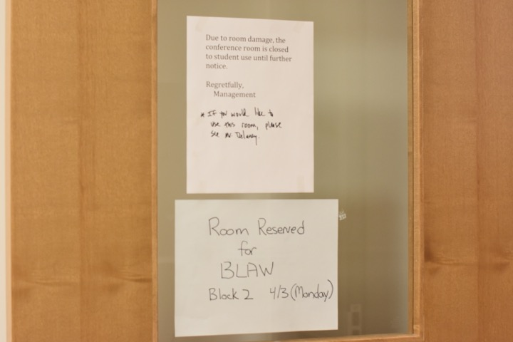 """A recently added sign on the History Department conference room. The room is still open for students to use, but due to a recent accident, it is now required for students to check in with Mr. Delaney before using it. """"We just need to recenter things for a while and then we can go back to our open door policy,"""" Delaney said."""