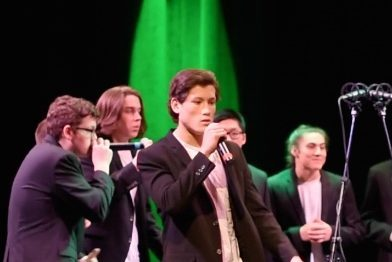 "Above, freshman Sidney Toga performs with the WHS T-Tones a cappella group. Toga has been singing since elementary school, and greatly enjoys making music. ""[Singing is] just fun,"" Toga said. ""I enjoy doing it, and it's just a fun thing to do for me."""