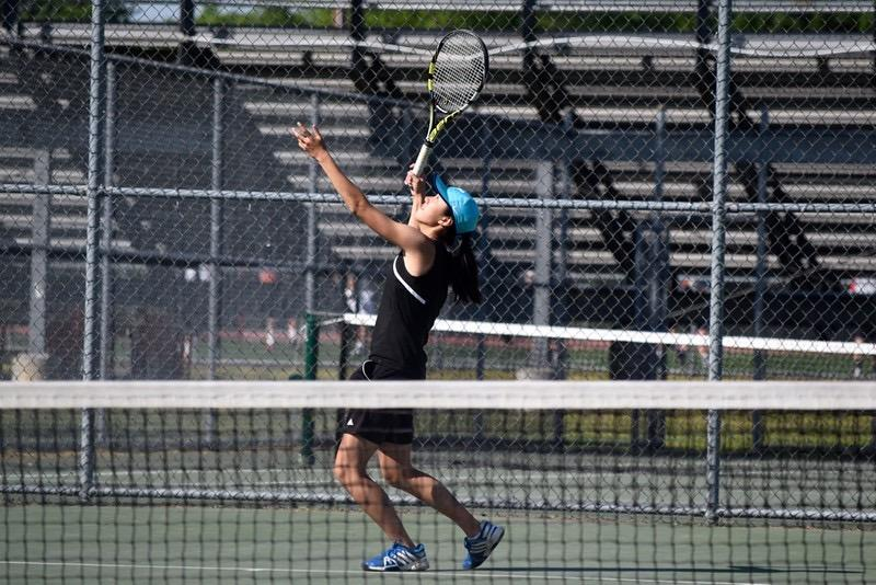 Above+is+senior+Sydney+Hsu+in+a+match.+Both+the+boys%27+and+girls%27+tennis+teams+have+advanced+to+the+MIAA+State+Finals+on+Wednesday.