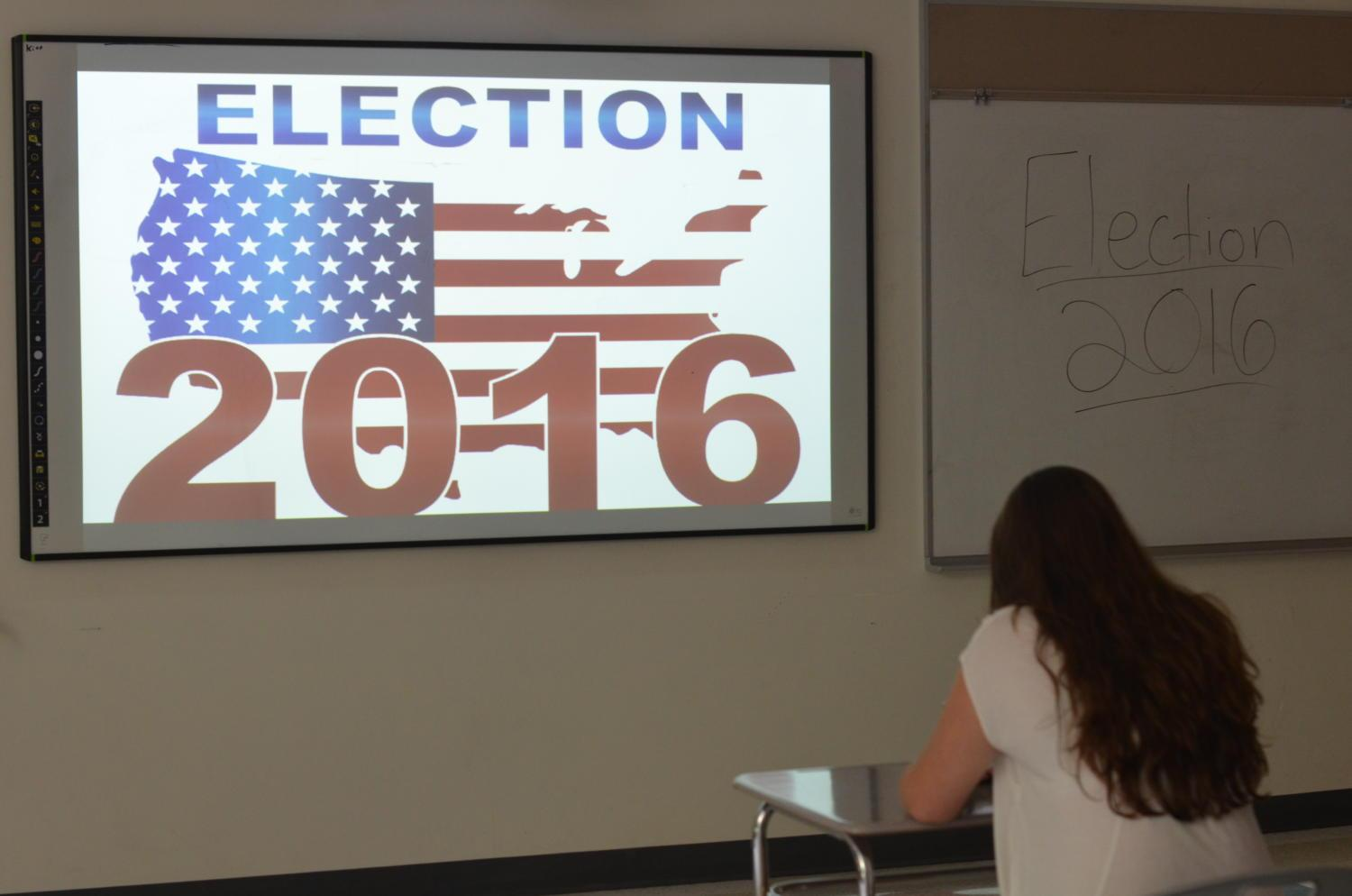 Photo Illustration: A student sits at her desk as her class discusses the 2016 election.