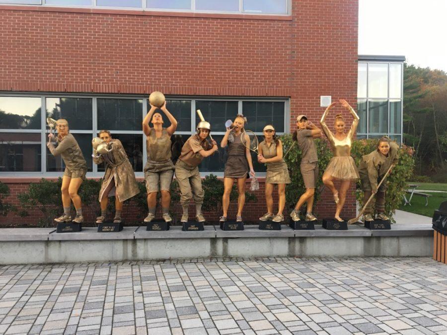 Seniors Ella Johnson, Nehda Khadjenoori, Savannah Salitsky, Darby Leid, Kayla Mabe, Lead Scheidemantel, Brooke LaPierre, Lindsey Barnard, and Lilly Lin dress as gold statues on Halloween.
